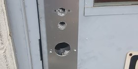 Cambridge locksmith installs new Unican lock on rear exit door.  Pop-A-Lock on the scene.